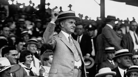 President Calvin Coolidge tosses out the ceremonial first ball in a 1925 game between the Washington Senators and the Philadelphia Athletics.