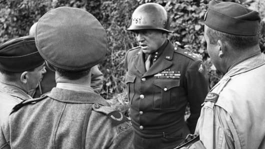 American General George S. Patton talks to Allied war correspondents in Normandy, France, in 1944.