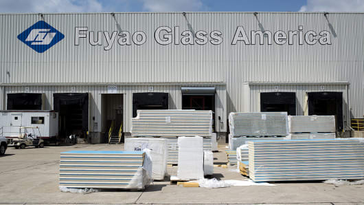 Construction materials sit in front of the loading docks at the Fuyao Glass America production facility in Moraine, Ohio, U.S., on Friday, Aug. 19, 2016.