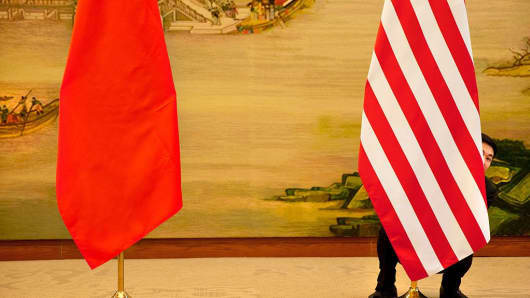A U.S. flag is tweaked ahead of a news conference between U.S. Secretary of State John Kerry and Chinese Foreign Minister Wang Yi at the Ministry of Foreign Affairs in Beijing on January 27, 2016.
