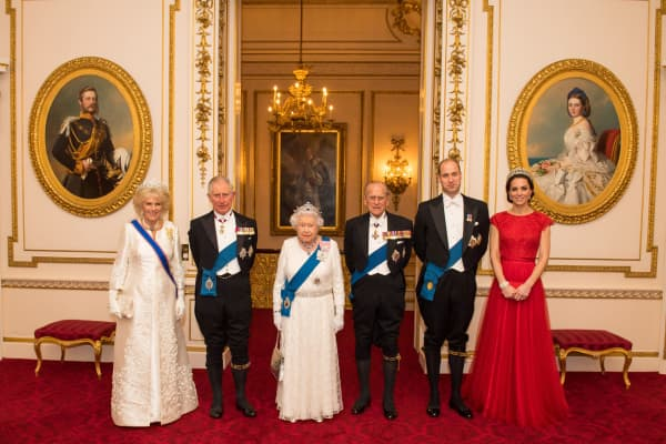 Royal family members pose for a photograph ahead of the annual evening reception for members of the Diplomatic Corps at Buckingham Palace