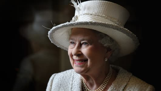 Queen Elizabeth II smiles as she visits Cyfarthfa High School and Castle on April 26, 2012