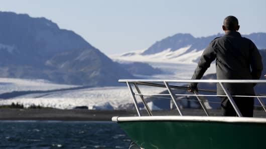 President Barack Obama views Bear Glacier on a boat tour of Kenai Fjords National Park in Seward, Alaska September 1, 2015.