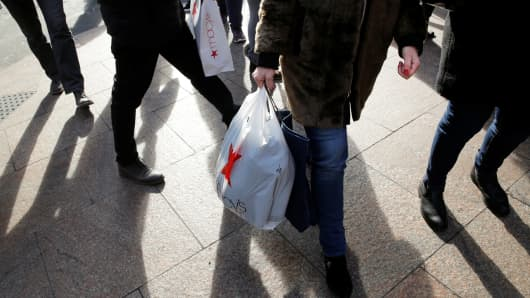 People carry shopping bags outside Macy's Herald Square in New York.