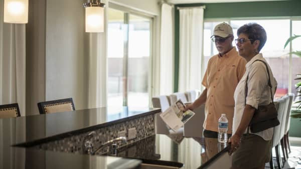 Prospective home buyers view a kitchen while touring a model home in Albuquerque, New Mexico.