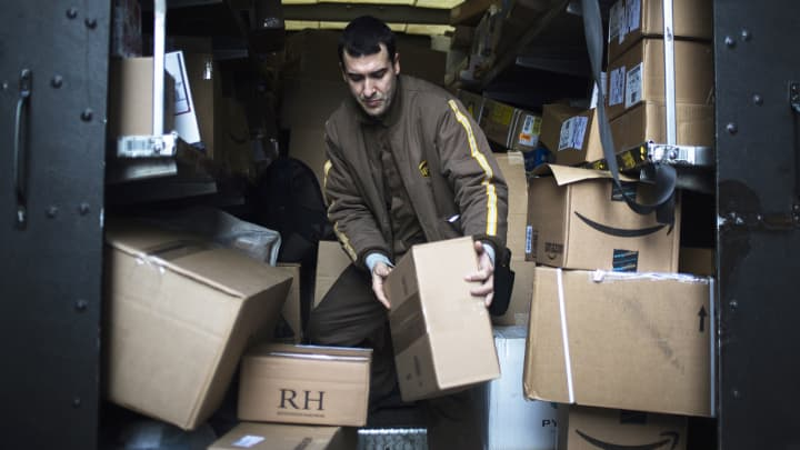 A United Parcel Service driver moves a package out for delivery in New York.