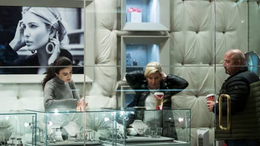 People browse jewelry at the 'Ivanka Trump Collection' shop at Trump Tower, December 8, 2016 in New York City.