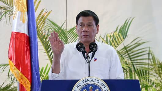 Philippine President Rodrigo Duterte gestures during a speech.