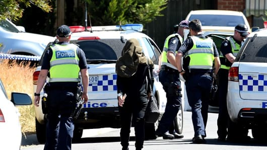 Members of Victoria Police are seen at a suburban street in Meadow Heights following raids which have foiled a suspected Christmas Day terror attack plot on December 23, 2016 in Melbourne, Australia.