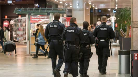 Police officers patrol at one of Germany's largest shopping and leisure centers on December 22, 2016, in Oberhausen, Germany.