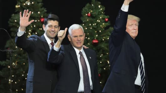 Paul Ryan (L), speaker of the U.S. House of Representatives, Vice President-Elect Mike Pence (C), and President-Elect Donald Trump leave the stage after speaking to supporters at a Thank You Tour 2016 rally on December 13, 2016 in West Allis, Wisconsin.