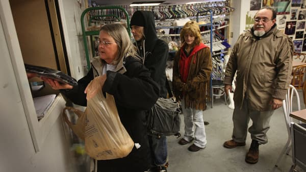 People receive donated bread at the Sugartree Ministries soup kitchen in Ohio.