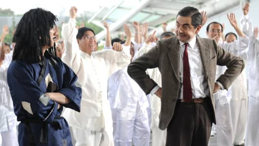 Actor Rowan Atkinson as Mr. Bean performs square dance during a programme recording on August 21, 2014 in Shanghai, China.