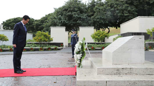 Japanese Prime Minister Shinzo Abe visits the National Memorial Cemetery of the Pacific at the Punchbowl in Honolulu, Hawaii on December 26, 2016.