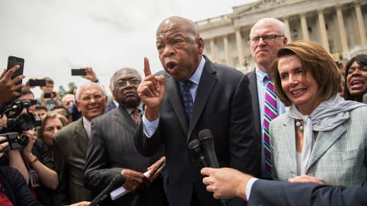 Rep. John Lewis, D-Ga., and House Minority Leader Nancy Pelosi, D-Calif., along with other members, address demonstrators on the East Front of the Capitol after the House Democrats' sit-in ended on the floor, June 23, 2016.