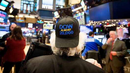 A trader wearing a 'DOW ALMOST 20,000' hat works on the floor of the New York Stock Exchange (NYSE) in New York, U.S., on Wednesday, Dec. 21, 2016.
