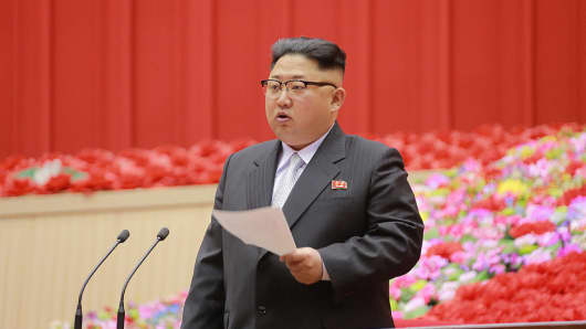 This picture released on December 26, 2016 from North Korea's official Korean Central News Agency (KCNA) shows North Korean leader Kim Jong-Un (C) delivering a speech at the First Conference of Chairpersons of the Primary Committees of the Workers' Party of Korea (WPK) at Pyongyang Indoor Stadium in Pyongyang.