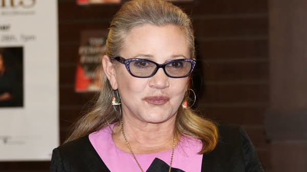 Actress Carrie Fisher signs copies of her new book 'The Princess Diarist' at Barnes & Noble at The Grove on November 28, 2016 in Los Angeles, California.