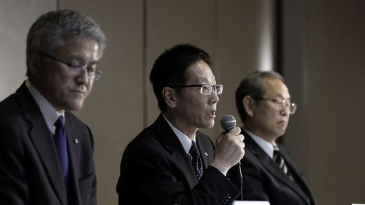 Masayoshi Hirata, CFO of Toshiba, center, speaks while Mamoru Hatazawa, VP of Nuclear Energy Systems & Services Division at Toshiba, left, and Satoshi Tsunakawa, president of Toshiba, look on during a news conference on Tuesday, Dec. 27, 2016.