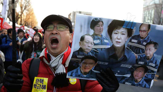 Protesters gathered and occupy major streets in the city center for a rally against South Korean President Park Geun-Hye on December 10, 2016 in Seoul, South Korea.