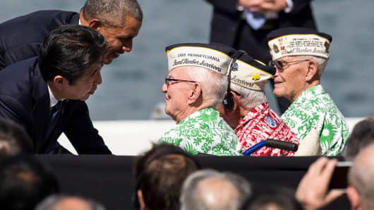 U.S. President Barack Obama and Japanese Prime Minister Shinzo Abe greet Pearl Harbor survivors Emmet Hyland, Al Rodriguez and Sterling Cane at Joint Base Pearl Harbor Hickam's Kilo Pier on December 27, 2016 in Honolulu, Hawaii.