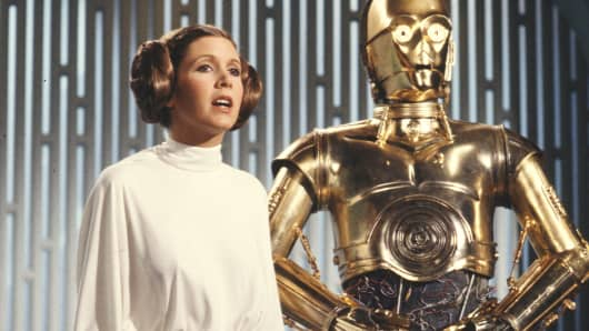 "Carrie Fisher (as Princess Leia Organa) and Anthony Daniels (as C3PO) star in the CBS television ""The Star Wars Holiday Special."""