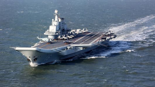 This photo taken on December 24, 2016 shows the Liaoning, China's only aircraft carrier, sailing during military drills in the Pacific.