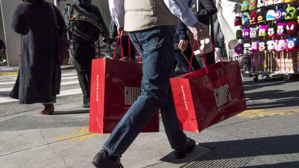A shopper carries Gump's shopping bags in San Francisco.