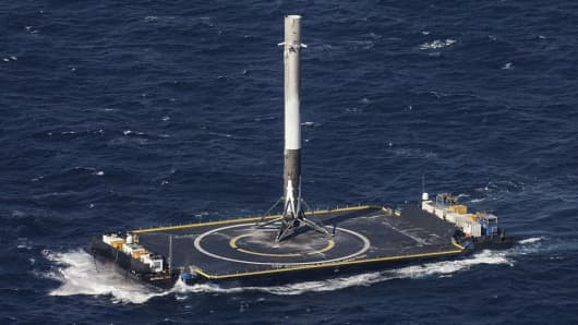 SpaceX's Falcon 9 rocket stands after making its first successful upright landing on the 'Of Course I Still Love You' droneship on April 8, 2016 some 200 miles off shore in the Atlantic Ocean after launching from Cape Canaveral, Florida.