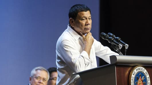 Rodrigo Duterte, the Philippines' president, pauses during an event with the Filipino community in Singapore, on Friday, Dec. 16, 2016.