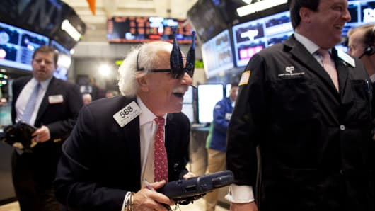 Traders wear 2013 New Years party glasses while they work on the floor of the New York Stock Exchange December 31, 2012 in New York City