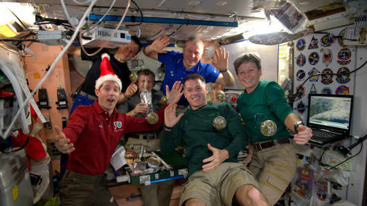 All six members of the Expedition 50 crew aboard the International Space Station celebrated the holidays together with a festive meal.