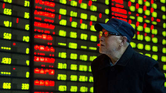 An investor obverses the screen at an exchange hall in Nanjing, China.