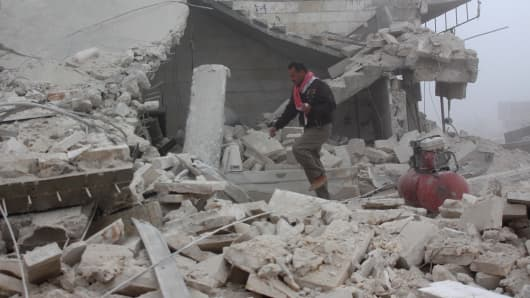 A man inspects the area after warcrafts belonging to Assad Regime forces attacked with vacuum bomb to Etarib district of Aleppo, Syria on January 1, 2017. Assad regime and its supporter foreign terrorists violate the ceasefire between Syrian opposition groups and the Syrian government.