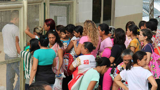 Relatives of inmates ask for information at the main gate of the Anisio Jobim Penitentiary Complex on January 2, 2017.