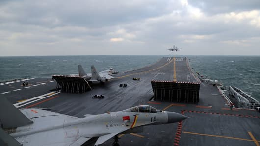 This photo taken on December 23, 2016 shows Chinese J-15 fighter jets being launched from the deck of the Liaoning aircraft carrier during military drills.