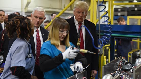 President-elect Donald Trump(R) and Vice President-elect Governor Mike Pence visit the Carrier air conditioning and heating company in Indianapolis, Indiana on December 1, 2016.