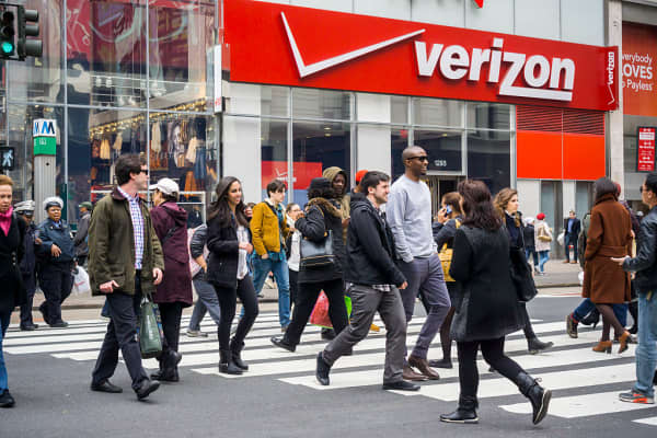Pedestrians cross Herald Square in front of a Verizon Wireless store in New York.