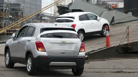 General Motors Co. Chevrolet Trax LT vehicles are driven up the ramp to a cargo ship at the Port of Veracruz in Veracruz, Mexico.