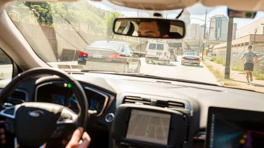 A driver looks from an Uber self-driving car on September 13, 2016 in Pittsburgh, Pennsylvania.