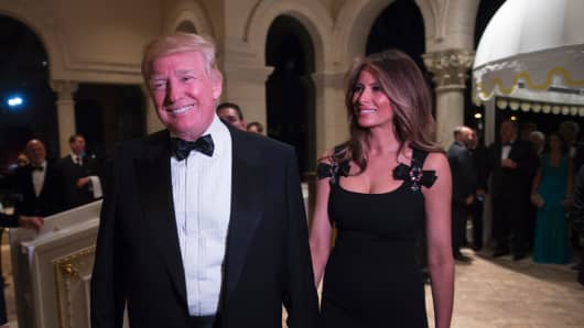 President-elect Donald Trump arrives with his wife Melania for a New Year's Eve party December 31, 2016 at Mar-a-Lago in Palm Beach, Florida.