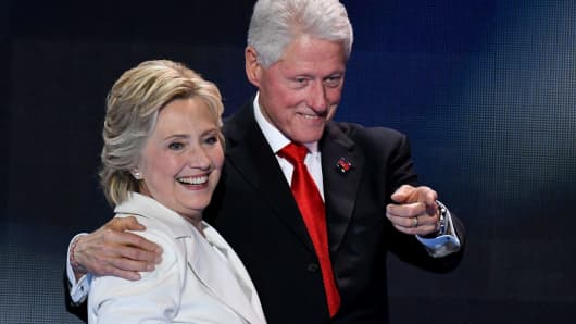 Bill Clinton joins Hillary Clinton on stage after her acceptance speech for the nomination to be President at the Democratic National Convention in Philadelphia last July.