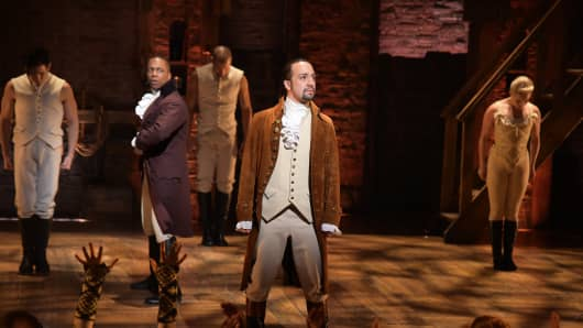 Actor Leslie Odom, Jr. (L) and actor, composer Lin-Manuel Miranda (R) and cast of 'Hamilton' perform on stage during 'Hamilton' GRAMMY performance for The 58th GRAMMY Awards at Richard Rodgers Theater in New York City.