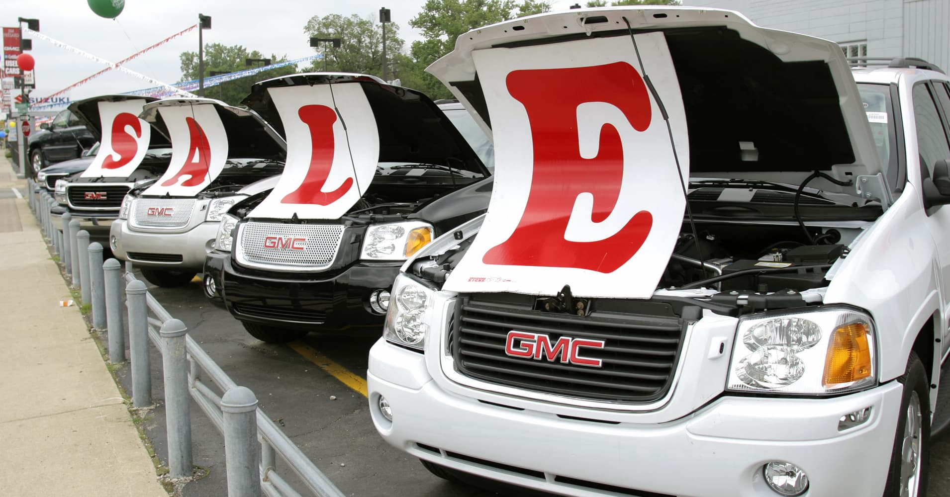 Sale signs lie on vehicles at a General Motors Chevrolet dealership in Ferndale, Michigan.