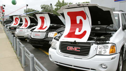 Sale signs on vehicles at a General Motors Chevrolet dealership in Ferndale, Michigan.
