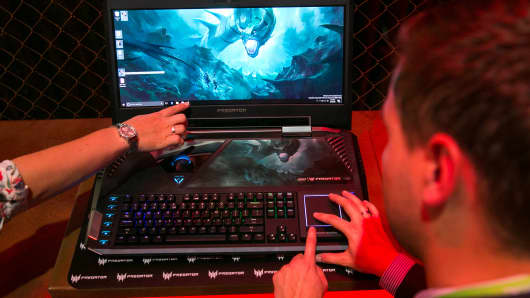 A visitor tests a Predator 21 X gaming laptop computer during the IFA International Consumer Electronics Show in Berlin, Germany, on Thursday, Sept. 1, 2016.