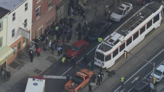 Emergency workers on scene of SEPTA trolley crash in Philadelphia.
