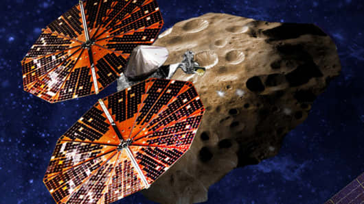 An artist's conception of the Lucy spacecraft flying by the Trojan Eurybates – one of the six diverse and scientifically important Trojans to be studied.