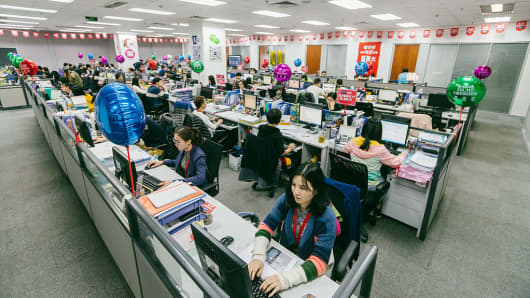 Customer-service workers in the headquarters of an apparel manufacturer on November 10, 2016 in Huizhou, Guangdong.