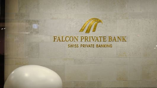 The logo of the Swiss Falcon Private Bank is pictured late on October 13, 2016 at the Falcon headquarters in Zurich.